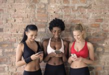 fitness freak girl using smartphone apps
