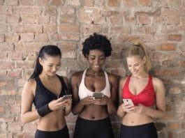 fitness freak girl using smartphone apps